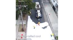 ロサンゼルス「道路を白く塗って温度下げたろ」