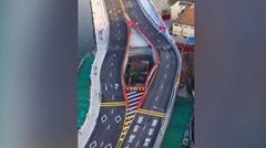 中国人 立ち退きを拒否したら家が橋に囲まれる